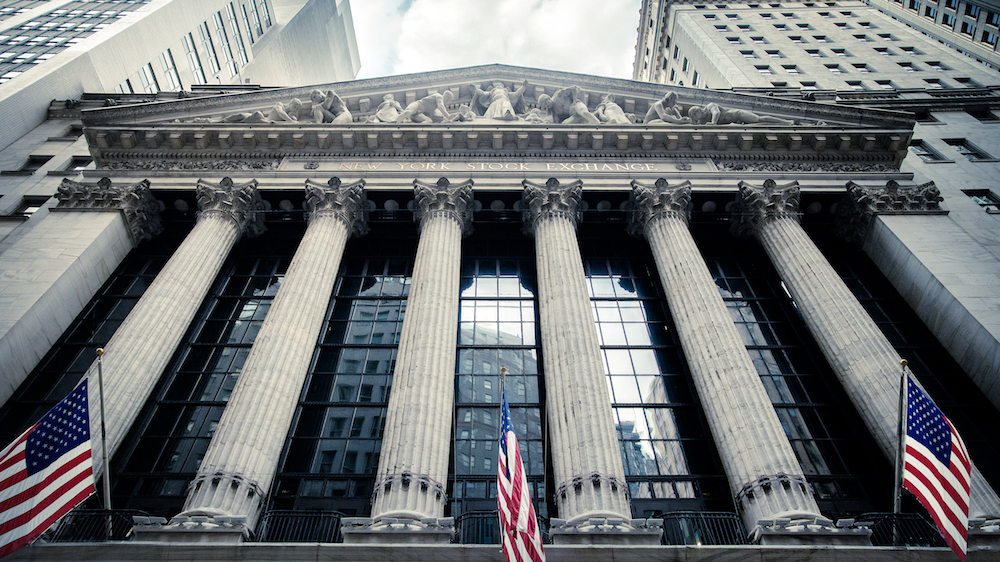 New York Stock Exchange with American flags hanging out front